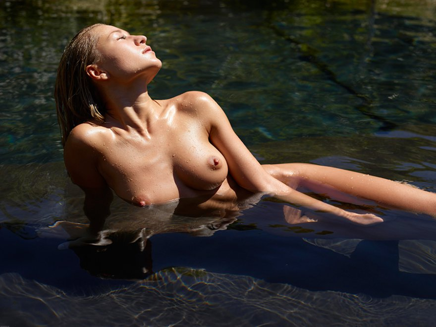 Naked brunette in the water