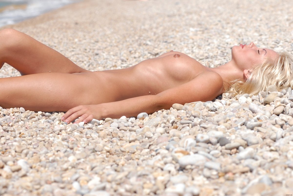 Nude by the beach