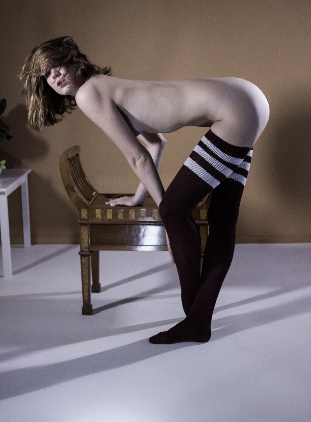 в полосатых чулочках порно фото